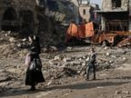 PHOTO: A Syrian woman walks with her daughter through the destruction in the old city of Aleppo, Syria, Jan. 19, 2017.