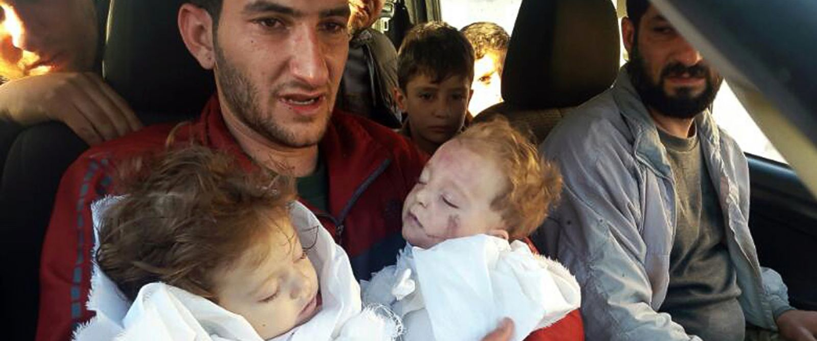 PHOTO: In this picture taken on Tuesday April 4, 2017, SAbdul-Hamid Alyousef, 29, holds his twin babies who were killed during a suspected chemical weapons attack, in Khan Sheikhoun in the northern province of Idlib, Syria.