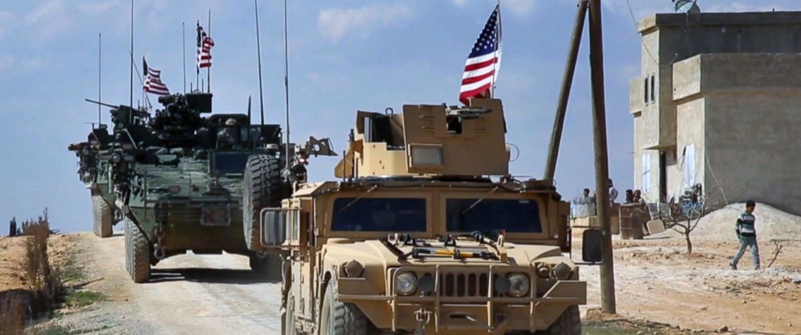 PHOTO: This frame grab from video provided by Arab 24 network, shows U.S. forces patrol on the outskirts of the Syrian town, Manbij, March 7, 2017.