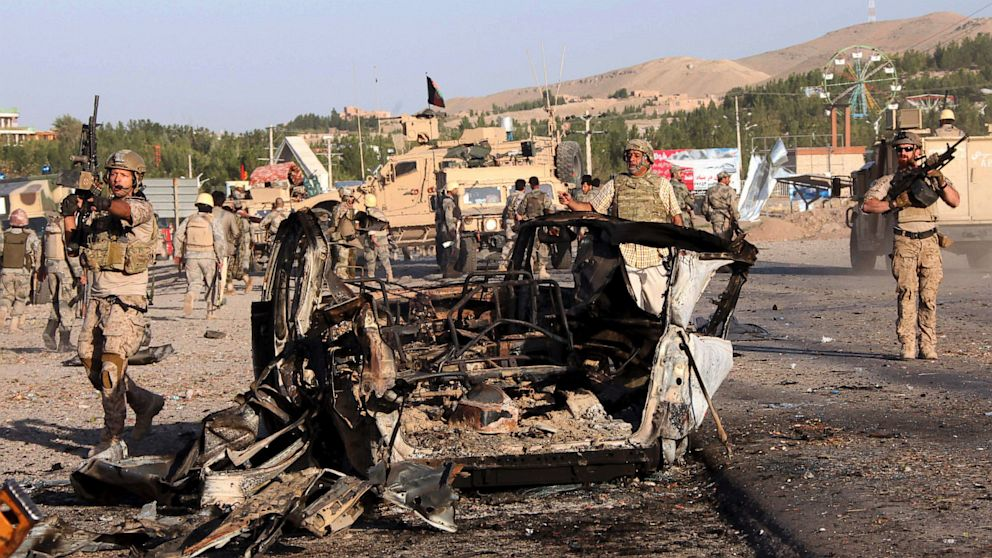 PHOTO: U.S.-led troops investigate the site of a suicide car bombing and a gunfight near the U.S. consulate in Herat Province, west of Kabul, Afghanistan, Friday, Sept. 13, 2013.