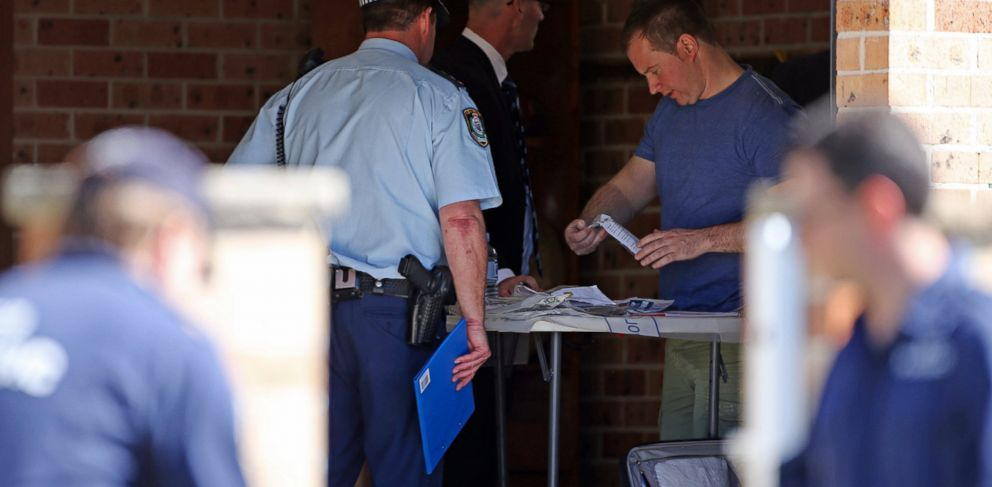 PHOTO: Police investigators work in a garage at a home at Guildford in suburban Sydney, Australia after federal and state police officers raided more than two dozen properties as part of the operation, Sept. 18, 2014.