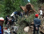 PHOTO: People try to get across a road blocked by a landslide following a powerful earthquake in Lushan county in southwest Chinas Sichuan province Saturday, April 20, 2013.