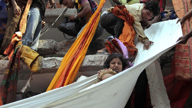 PHOTO: Rescue workers use pieces of clothes to bring down a survivor after an eight-story building housing several garment factories collapsed in Savar, near Dhaka, Bangladesh, Wednesday, April 24, 2013.