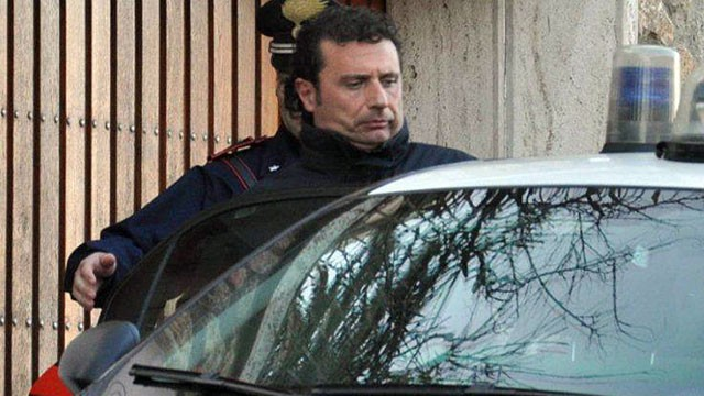 PHOTO: In this photo taken, Jan. 14, 2012, Francesco Schettino  the captain of the luxury cruiser Costa Concordia, which ran aground off Italy's Tuscan coast, enters a Carabinieri car in Porto Santo Stefano, Italy.
