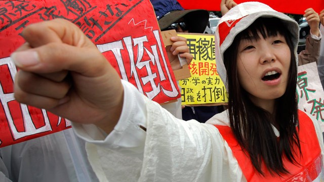 PHOTO: A demonstrator raises clenched fist during a rally, protesting against restarting the Ohi nuclear power plants reactors in front of the prime ministers official residence in Tokyo, Saturday, June 16, 2012.