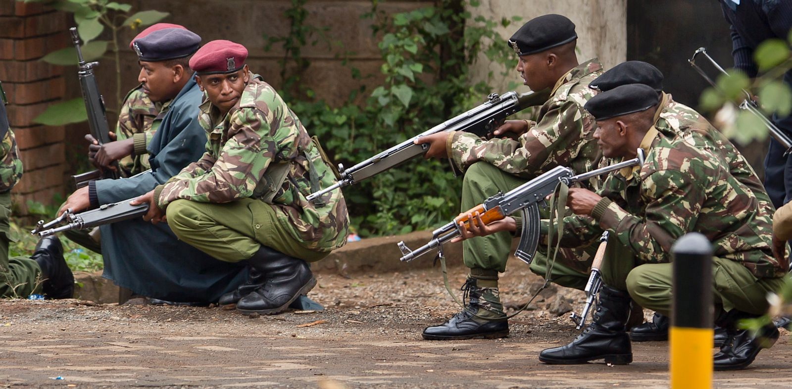 PHOTO: Armed police from the General Service Unit take cover behind a wall during a bout of gunfire, outside the Westgate Mall in Nairobi, Kenya Monday, Sept. 23, 2013.