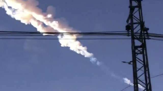 PHOTO: A meteorite contrail is seen in Chelyabinsk region on Friday, Feb. 15, 2013. A meteor streaked across the sky of Russia?s Ural Mountains, causing sharp explosions and reportedly injuring around 100 people, including many hurt by broken glass.