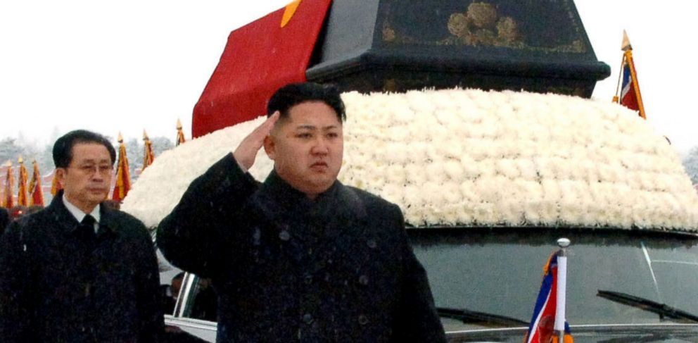 PHOTO: In this Dec. 28, 2011 file photo, North Koreas leader, Kim Jong Un, front center, is followed by his uncle Jang Song Thaek, as he salutes beside the hearse carrying the body of his late father North Korean leader Kim Jong Il.