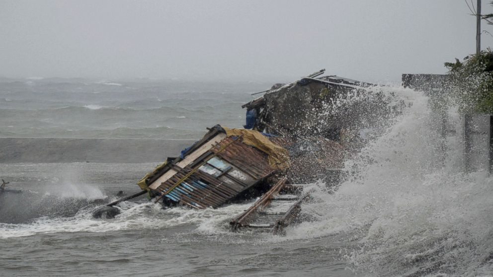 PHOTO: A house is engulfed by the storm surge brought about by powerful typhoon Haiyan that hit Legazpi city, Albay province Friday Nov.8, 2013 about 325 miles south of Manila, Philippines.