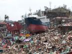 PHOTO: A ship lies on top of damaged homes after it was washed ashore in Tacloban city, Leyte province, central Philippines on Sunday, Nov. 10, 2013.