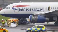 PHOTO: Emergency services attend a British Airways passenger plane after it had to make an emergency landing at London's Heathrow Airport Friday May 24, 2013.