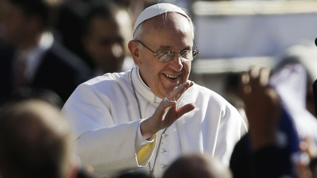 PHOTO: Pope Francis waves to crowds as he arrives to his inauguration Mass in St. Peter's Square at the Vatican, Tuesday, March 19, 2013.