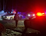 PHOTO: Police vehicles block a road just outside the town of Chertsey, Quebec, Sunday, March 17, 2013, during a search for escaped prisoners.