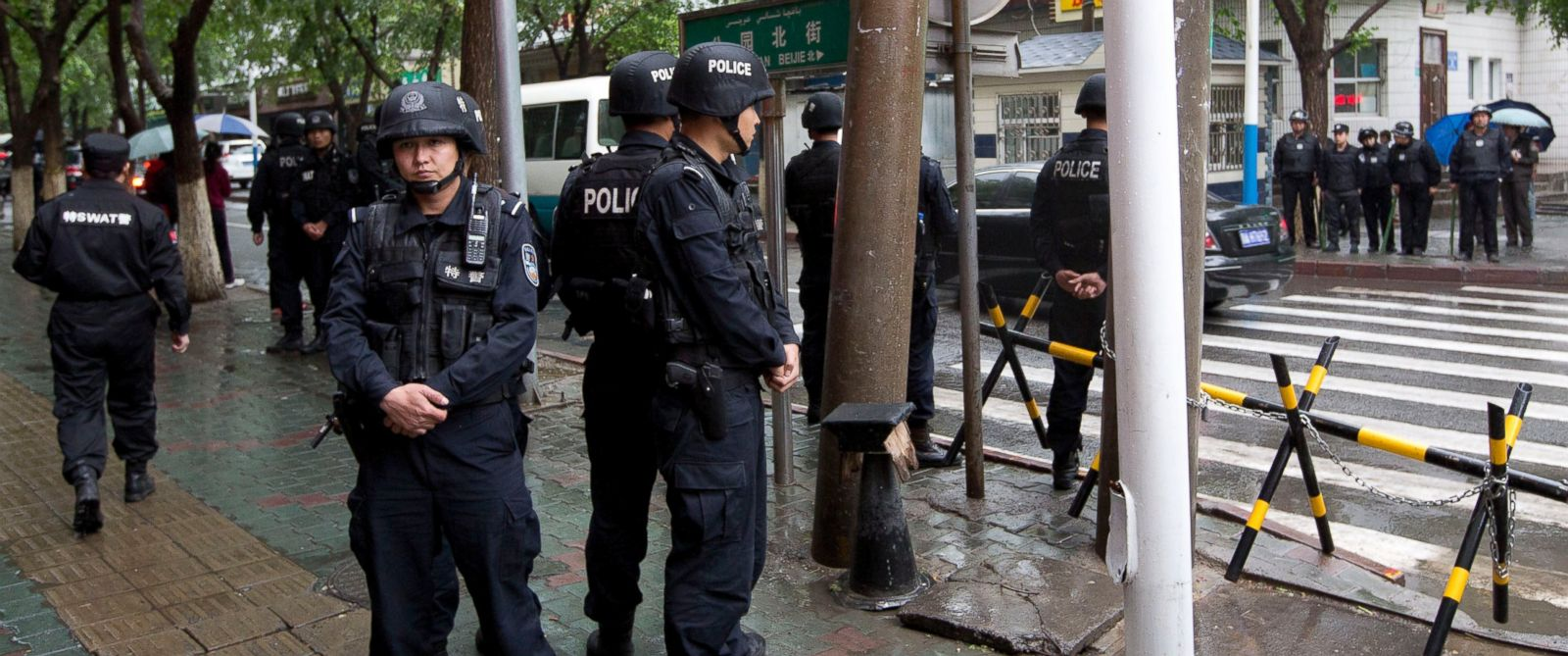 PHOTO: Armed policemen stand guard near the site of an explosion in Urumqi, northwest Chinas Xinjiang region, May 22, 2014.