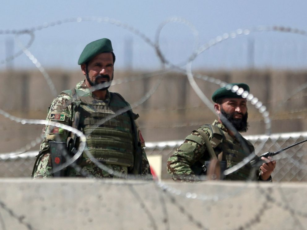 PHOTO: Afghanistan National Army soldiers stand guard at a gate of Camp Qargha, west of Kabul, Afghanistan, Aug. 5, 2014.