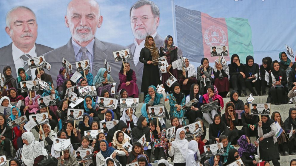 PHOTO: Female supporters of Afghan presidential candidate Ashraf Ghani Ahmadzai listen to his speech during a campaign rally in Kabul, Afghanistan, April 1, 2014. Elections will take place on April 5, 2014.