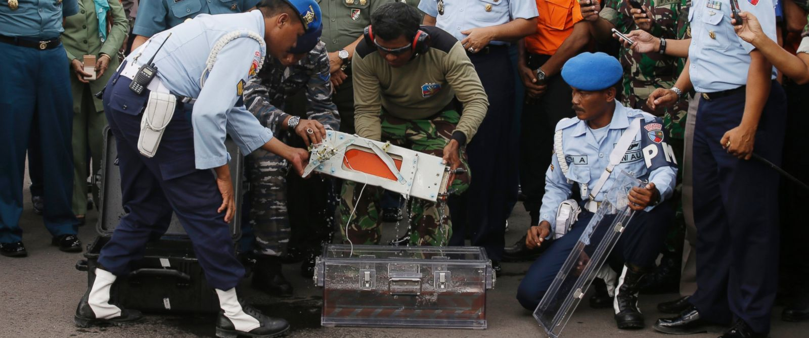PHOTO: Indonesian air force and Indonesian navy personnel hold one of the black boxes of AirAsia Flight 8501 that crashed in the Java Sea, at airport in Pangkalan Bun, Indonesia, Jan. 12, 2015.