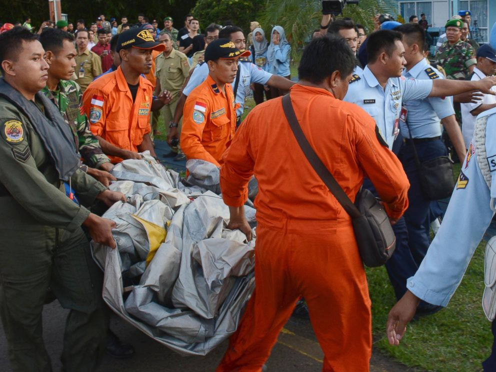 PHOTO: Indonesian Air Force personnel carry debris from AirAsia Flight 8501 at the airbase in Pangkalan Bun, Central Borneo, Indonesia, Dec. 30, 2014.