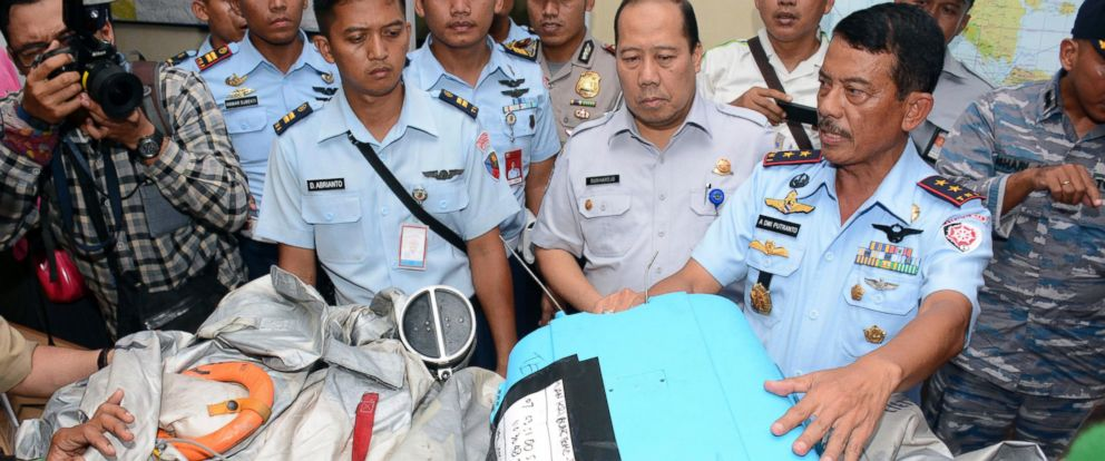 PHOTO: Indonesian Air Force officials show AirAsia Flight 8501 debris during a press conference at the airbase in Pangkalan Bun, Central Borneo, Indonesia, Dec. 30, 2014.