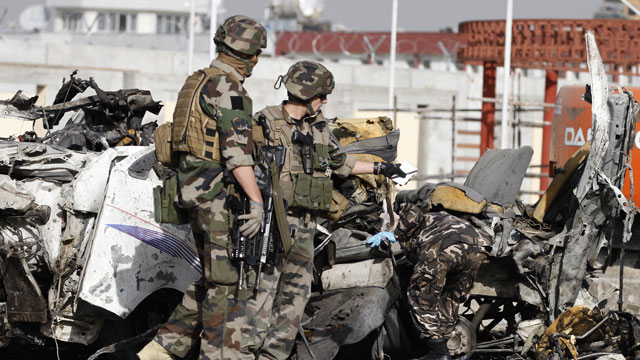 PHOTO: French soldiers arrive at the scene of a suicide bombing, Tuesday, Sept. 18, 2012 in Kabul, Afghanistan. A suicide bomber rammed a car packed with explosives into a mini-bus carrying foreign aviation workers to the airport in the Afghan capital.