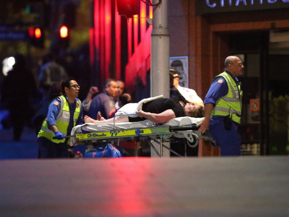 PHOTO: A injured hostage is wheeled to an ambulance after shots were fired during a cafe siege at Martin Place in the central business district of Sydney, Australia, Dec. 16, 2014.