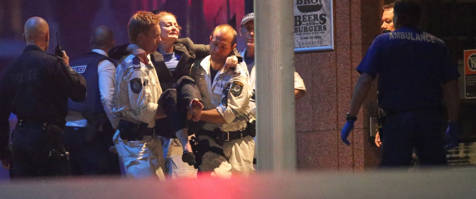 PHOTO: A injured hostage is carried to an ambulance after shots were fired during a cafe siege at Martin Place in the central business district of Sydney, Australia, Dec. 16, 2014.