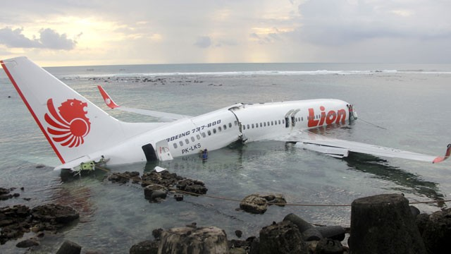 PHOTO: In this photo released by Indonesian Police, the wreckage of a crashed Lion Air plane sits on the water near the airport in Bali, Indonesia on Saturday, April 13, 2013.