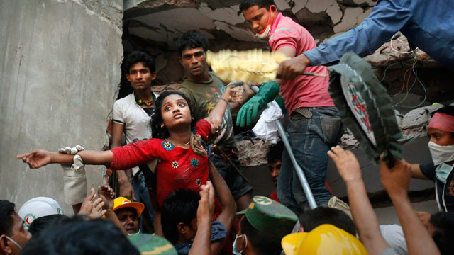 PHOTO: A Bangladeshi woman survivor is lifted out of the rubble by rescuers on April 25, 2013 at the site of a building that collapsed on April 24, 2013 in Savar, near Dhaka, Bangladesh.