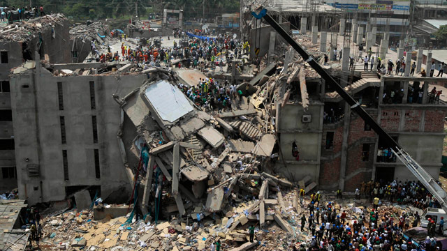PHOTO: Bangladesh rescuers look for survivors and victims at the site of a building that collapsed Wednesday in Savar, near Dhaka, Bangladesh,
