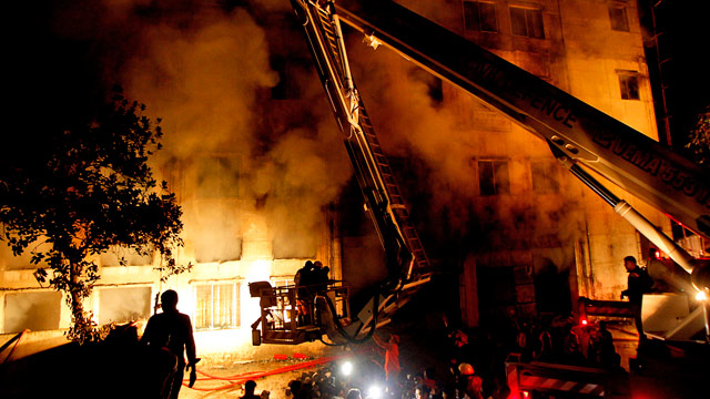 PHOTO: Bangladeshi firefighters battle a fire at a garment factory in the Savar neighborhood in Dhaka,