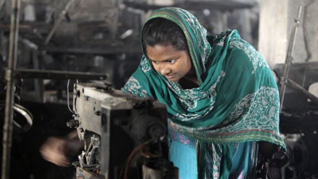 PHOTO: A Bangladeshi garment worker inspects the damaged machinery inside the Smart Export Garment Ltd. factory where a fire Saturday claimed the lives of seven of her female colleagues in Dhaka, Bangladesh, Sunday, Jan. 27, 2013.