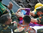 PHOTO: Rescuers carry a survivor pulled from the rubble of a building that collapsed in Saver, Bangladesh, May 10, 2013.