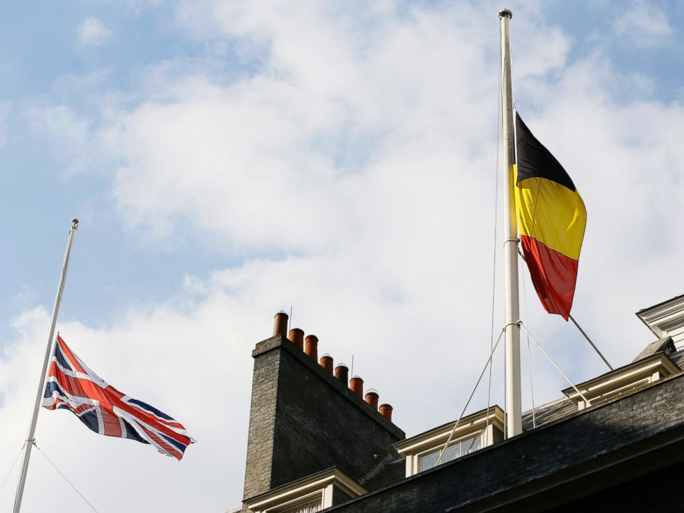 PHOTO: The Belgium and British flag fly at half staff above Downing Street in London, following the attacks in Brussels, March, 22, 2016.