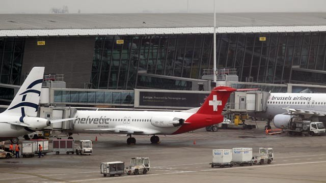 PHOTO: Baggage carts make their way past a Helvetic Airways aircraft from which millions' of dollars worth of diamonds were stolen on the tarmac of Brussels international airport, Feb. 19, 2013.