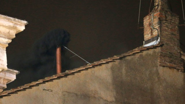 PHOTO: Blake smoke emerges from the chimney on the roof of the Sistine Chapel, in St. Peter's Square at the Vatican, March 12, 2013. The black smoke indicates that the new pope has not been elected yet.