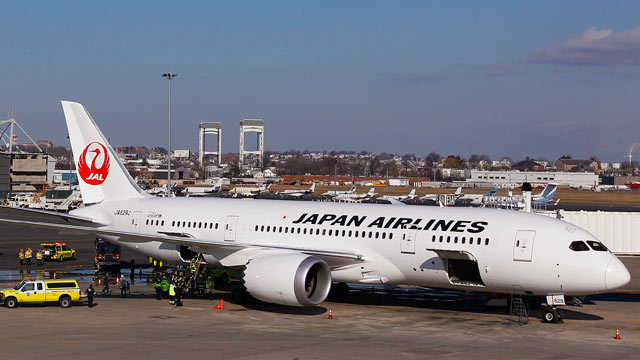 PHOTO: A Japan Airlines Boeing 787 Dreamliner jet aircraft is surrounded by emergency vehicles while parked at a terminal E gate at Logan International Airport in Boston, Jan. 7, 2013.