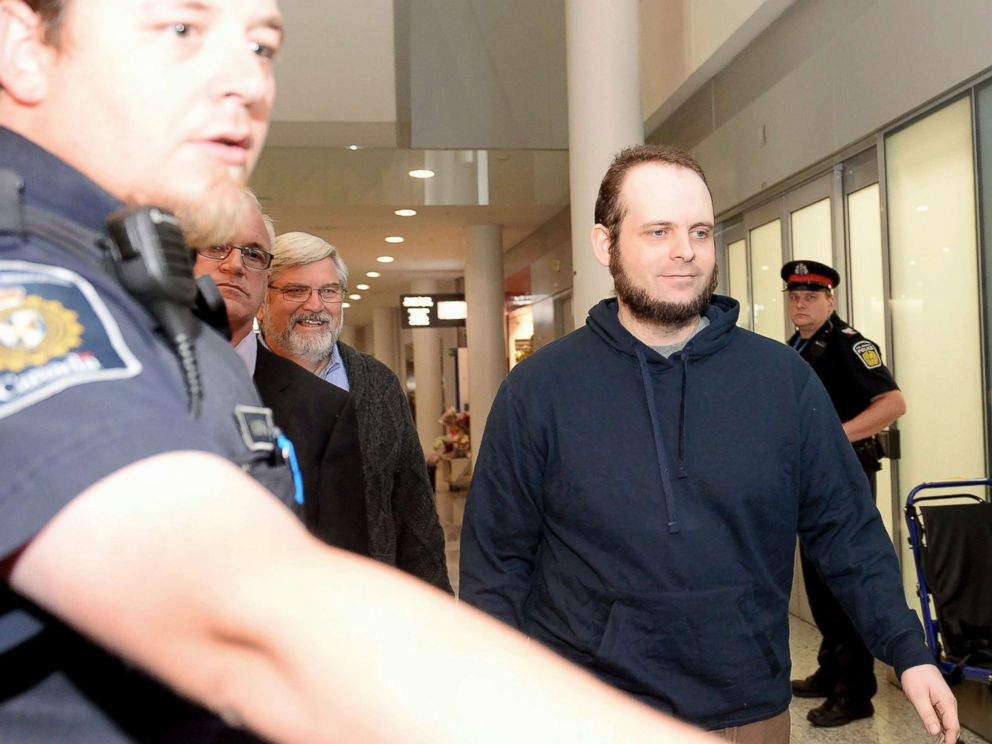 PHOTO: Joshua Boyle is escorted by authorities to a media availability at Torontos Pearson International Airport on Friday, Oct. 13, 2017.