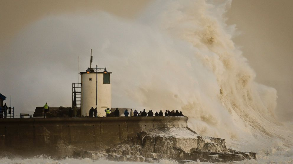 PHOTO: Waves break over Porthcawl harbour, south Wales, as the region continues to be battered by high winds and heavy rain.
