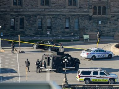 PHOTO: Police teams set up police tape outside Centre Block on Parliament Hill in Ottawa, Ontario, Oct. 22, 2014.