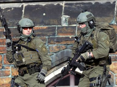PHOTO: A Royal Canadian Mounted Police intervention team responds to a reported shooting at Parliament Hill in Ottawa, Canada Oct. 22, 2014.