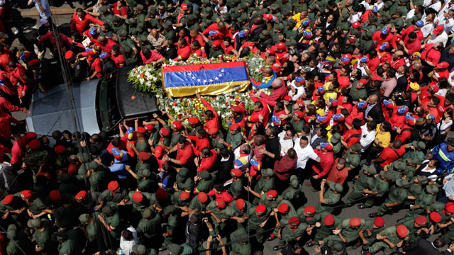 PHOTO: The flag-draped coffin containing the body of Venezuelas late President Hugo Chavez is taken from the hospital where he died, to a military academy where it will remain until his funeral in Caracas, Venezuela, March 6, 2013.