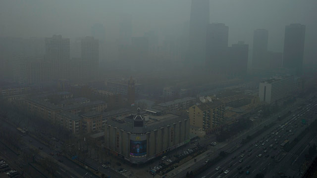 PHOTO: Skyscrapers are obscured by heavy haze in Beijing Sunday, Jan. 13, 2013.