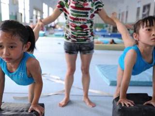 Photos: Chinese Gymnasts' Tough Training