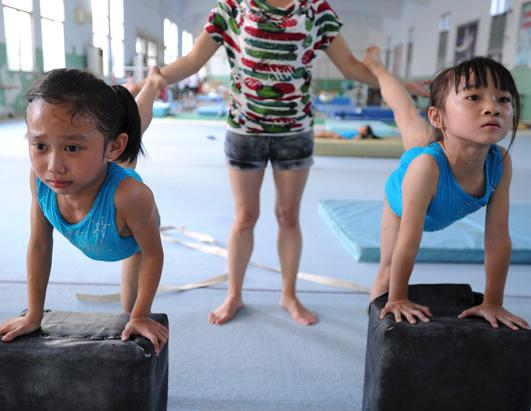 Tough Chinese sports schools teach children gymnastics