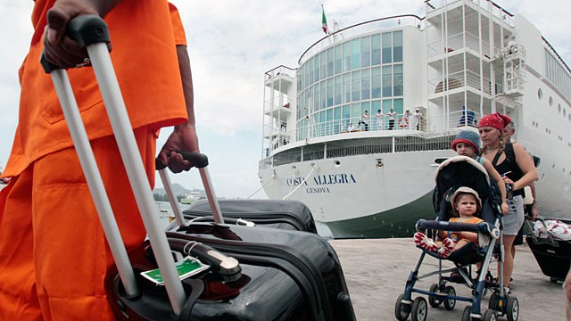PHOTO: Passengers of the Costa Allegra cruise ship wait to board on a ferry at Victoria's harbor, Seychelles Island, March 1, 2012.