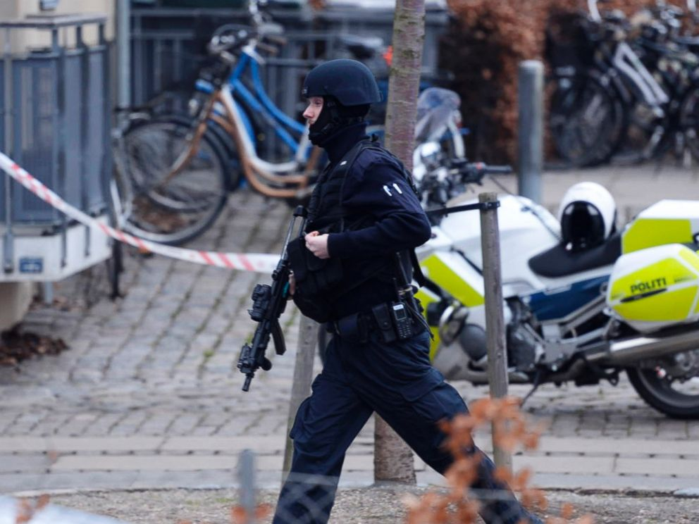 PHOTO: An armed security officer runs down a street near a venue after shots were fired where an event titled Art, blasphemy and the freedom of expression was being held in Copenhagen, Saturday, Feb. 14, 2015.