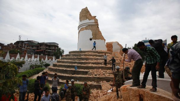 Volunteers work to remove debris at the historic Dharahara tower, a city landmark, after an earthquake in Kathmandu, Nepal, April 25, 2015.