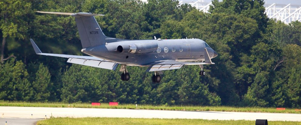 PHOTO: A private plane arrives at Dobbins Air Reserve Base in Marietta, Ga. transporting the second American stricken with Ebola, Nancy Writebol, on Aug. 5, 2014.