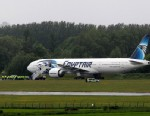 PHOTO: Passengers leave the Egyptair aircraft at  Prestwick Airport, Scotland,   after it was diverted while en route from Cairo to New York, Saturday June 15, 2013.