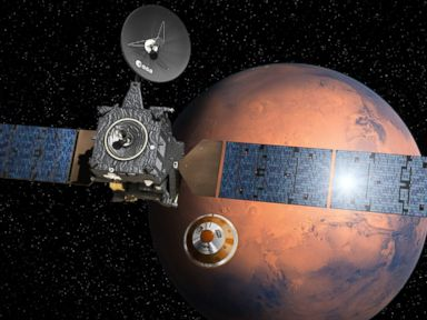 PHOTO: An artists depiction provided by the European Space Agency shows the separation of the ExoMars landing module from the Trace Gas Orbiter above Mars.